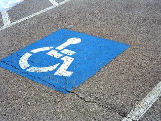 Handicapped parking for golf carts in Sebastian.