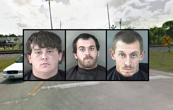 Indian River County Sheriff's Office detain three men for riding FEC railroad train.