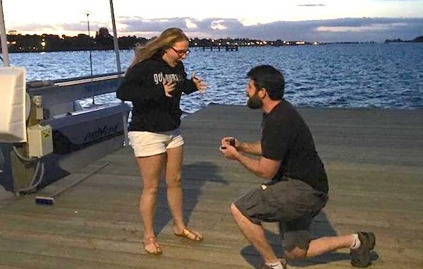 Arch McQuade asks Katie McGlaughlin for her hand in marriage on the pier at the Sebastian Tiki Bar & Grill.