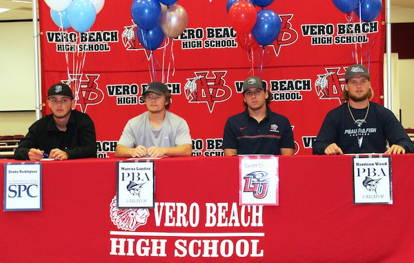 Drake Rodriguez, Marcus Lantier, Garrette Cooper, and Harrison Wood signed letters of intent at Vero Beach High School.