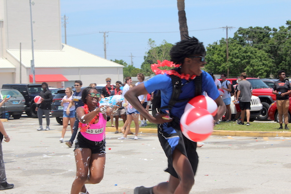 Vero Beach Seniors chase each other with squirt guns.