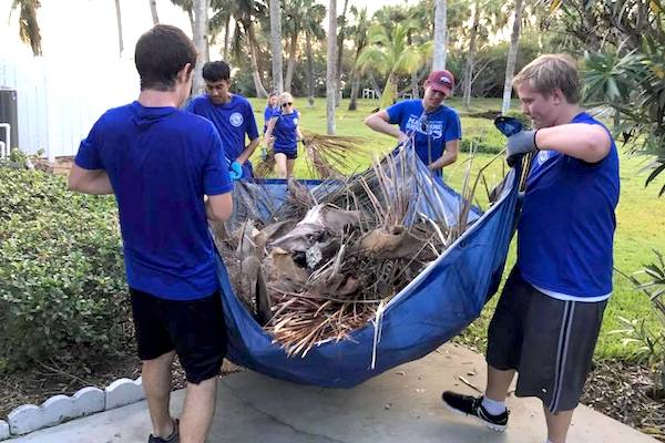 Cleaning up piles of debris left by Hurricane Irma.