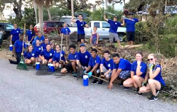 Sebastian River High School band members help clean up neighborhood.