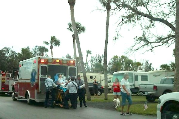 Man being carried into ambulance.