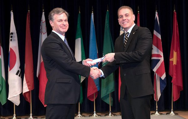 Major Eric Flower, on right in photo, graduates from the FBI Academy.
