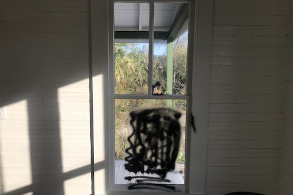 Window graffiti at historic house in Fellsmere.