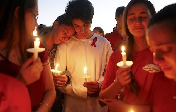 Students gather during a vigil for the victims of the shooting at Marjory Stoneman Douglas High School, in Parkland, Florida.