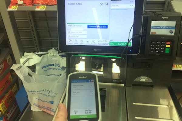 When done shopping, take the Scan & Go to Walmart's Self Checkout and scan the black barcode on the screen. (Photo: Andy Hodges)