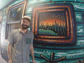 Nick Fisher, an artist from Sebastian, paints a mural at the Captain Hiram's Resort.