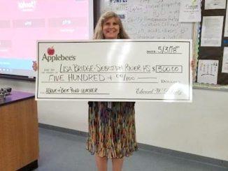 "Vero Beach Applebee's Presents $500 to Above and ""BEE""yond Teacher Contest Winner."