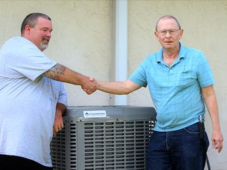 Man receives free air conditioning unit in Sebastian, Florida.