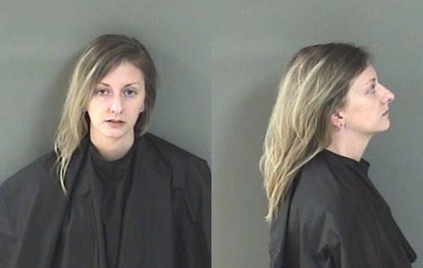 A woman was arrested after striking her boyfriend and punching holes in walls in Sebastian, Florida.