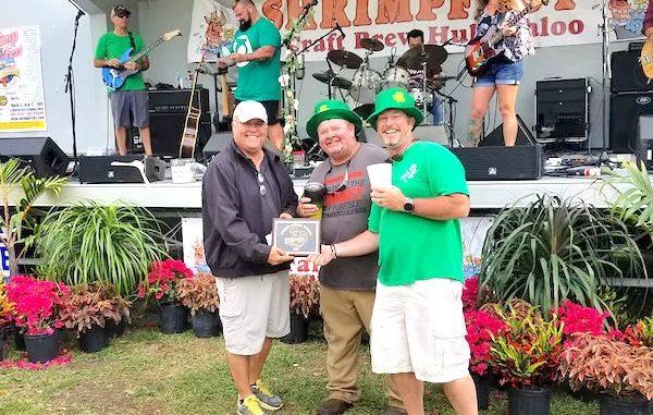Tiki Bar & Grill (owner John Campbell on right) wins Golden Shrimp Award at ShrimpFest in Sebastian, Florida.