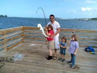 Girl catches shark off dock in Sebastian, Florida.
