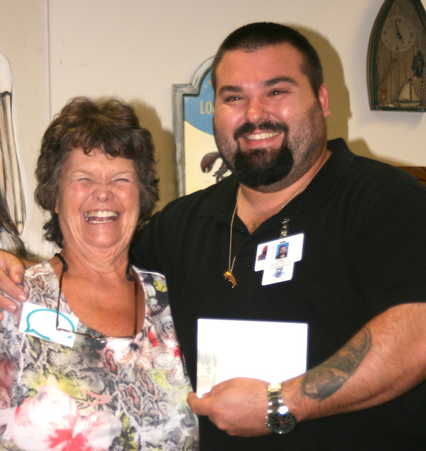 Sharon Mikesell presents donation to Eric Boscovich, SRHS Culinary Program teacher.