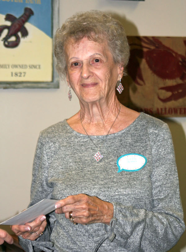 Grace Follett accepted donation on behalf of The Ecumenical Food Pantry.