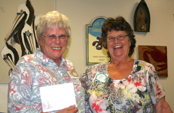 Lornna Mitchell accepted donation on behalf of S.O.S Cookies from Sharon Mikesell.
