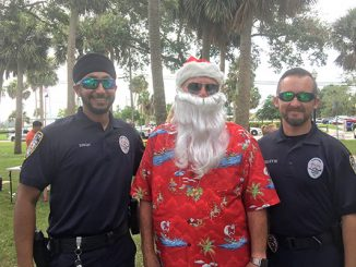 Christmas in July benefits Shop With A Cop in Sebastian, Florida.