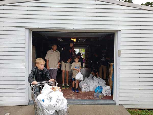 Boy Scouts help in fight against hunger during food drive in Sebastian, Florida.
