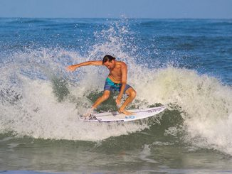 Anthony Osment riding waves at the Sebastian Inlet. (Photo by: Danielle Redden)