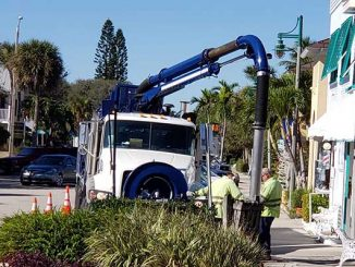 Vero Beach city workers clear drains clogged with confetti by Grind & Grape.