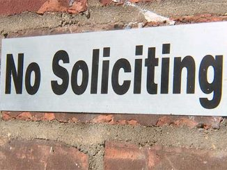 Sebastian councilwoman leaves her business card on a no soliciting sign.
