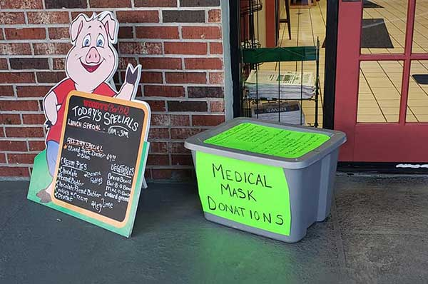 Medical mask donations collection at Woody's BBQ.