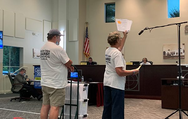 Tracey Cole, founder of the Sebastian Voters Against Gilliams and Parris PAC, shows the first round of signed petitions to recall Charles Mauti, Damien Gilliams, and Pamela Parris.