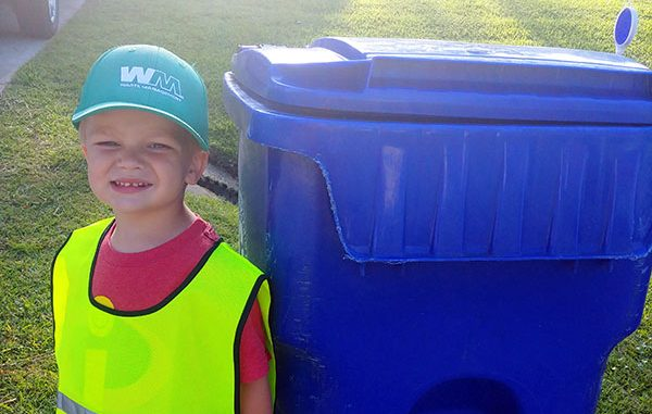 Roman, 3, started his own garbage can retrieval business.