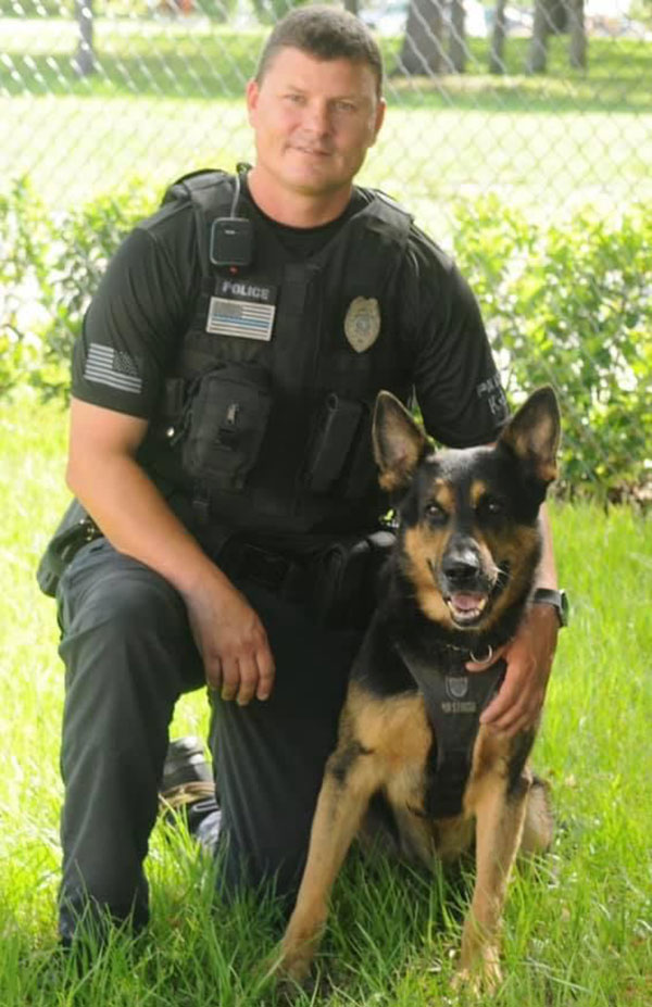 Corporal Ritchie Revis with K-9 Jery.